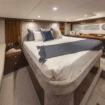 Riviera-5400-Sport-Yacht-Platinum-Edition-Forward-Master-Stateroom---Gloss-Walnut-Timber-Finish-03