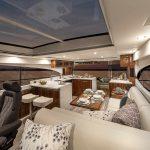 Riviera-5400-Sport-Yacht-Platinum-Edition-Saloon---Gloss-Walnut-Timber-Finish-01